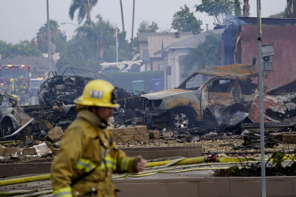 At least 2 dead in California plane crash that torched homes