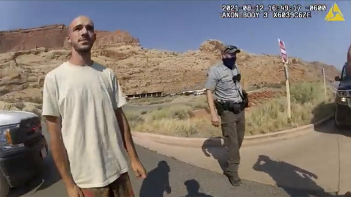 This police camera video provided by the Moab Police Department shows Brian Laundrie talking to a police officer after police pulled over the van he was traveling in with Gabby Petito near the entrance to Arches National Park on Aug. 12. (The Moab Police Department via AP)