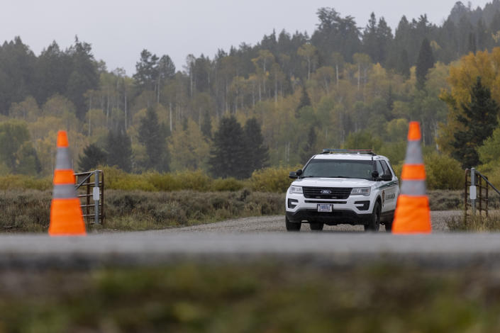A park ranger's vehicle sits at a road block near the entrance of Spread Creek Campground in Moran, Wyo., on Sept. 19. (Photo by Natalie Behring/Getty Images)