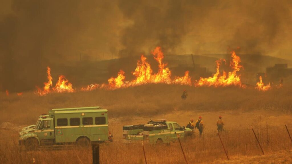 Monster California wildfire threatens homes and jumps major highway